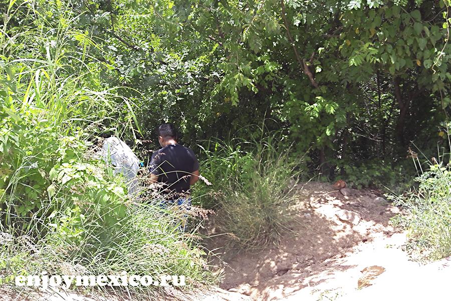 вход на пляж техонсито уатулько мексика